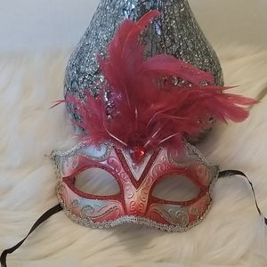 Beautiful red, gold and silver mardi gras mask